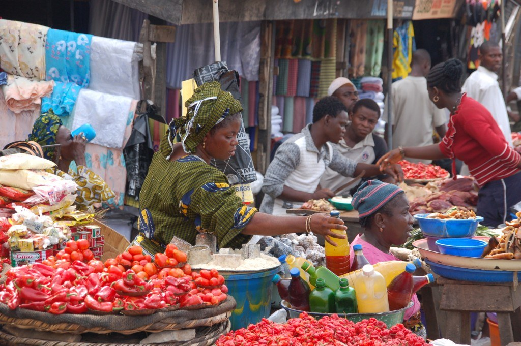 People at a fruit and vegetable market in Nigeria