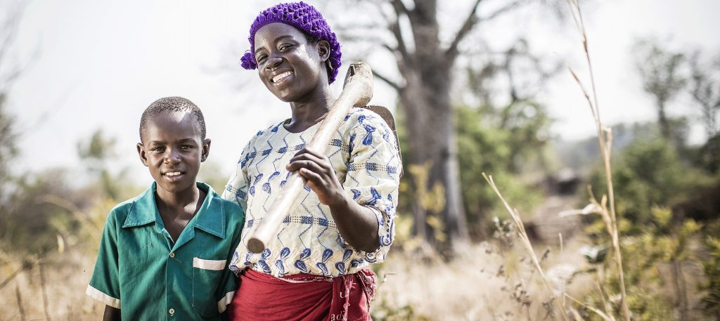 Boy and Girl standing in a field in Africa